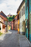 Stone paved old street with colored houses from Sighisoara fortr Stock Images