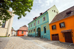 Stone paved old streets with colored houses from Sighisoara fort Royalty Free Stock Images