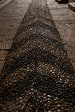 Stone paved pattern pathway. At Harem, Topkapi-sultan`s palace, in Istanbul, erroded by steps Stock Images