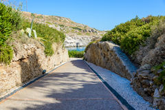 Stone paved road leading to the bay Royalty Free Stock Image