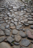Stone paved road Stock Images