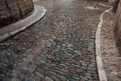 Stone paved road in the old city. Road from a stone in the ancient town Stock Photography
