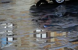 Stone paved road with puddles reflection royalty free stock photo