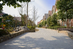 Stone paved street in exotic town at sunny winter noon Royalty Free Stock Images