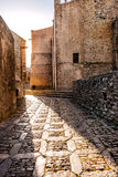 Stone paved street in rosy sunlight Royalty Free Stock Image