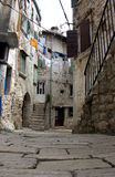 Stone paved street in Rovinj,Croatia. Old,stone paved street in Rovinj,Croatia Royalty Free Stock Images