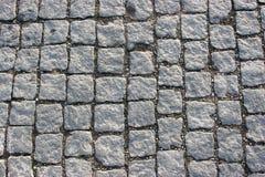 Stone pavement. Symmetrically aligned traditional stone pavement Royalty Free Stock Photo