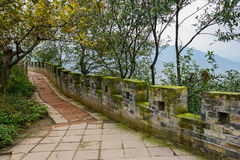 Stone pavement along ancient parapet in cloudy winter afternoon Stock Images