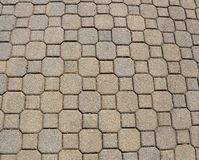 Stone pavement. A pavement composed of stone bricks arranged in a pattern Stock Photos