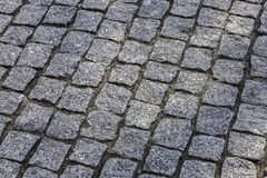 Stone pavement in the form of squares Royalty Free Stock Photo