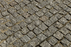 Stone pavement in the form of squares Royalty Free Stock Photos