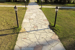 Stone pavement in garden Stock Images