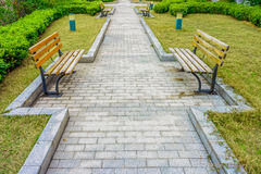 The stone pavement in a garden Royalty Free Stock Images