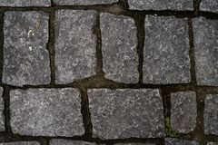 Stone pavement with grass stock photos