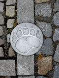 Stone pavement with a metallic bear track Stock Photo
