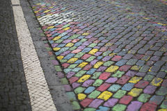 Stone pavement painted different bright colors. Abstract. Royalty Free Stock Image