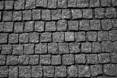 The stone pavement. Pavement of cobblestones. Background Stock Photo