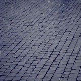Stone pavement with soap bubbles floating around vintage effect. Stock Photos