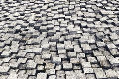 Stone pavement texture. Granite cobble stoned pavement background. Abstract background of old cobblestone pavement close-up 2 royalty free stock photography