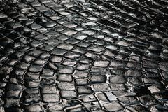 Stone pavement texture. Granite cobble stoned pavement background. Abstract background of old cobblestone pavement close. Up. An old road lined with cobblestone Royalty Free Stock Image