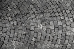 Stone pavement texture. Granite cobble stoned pavement background. Abstract background of old cobblestone pavement close Royalty Free Stock Photo