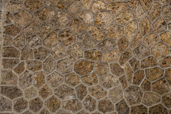 Stone pavement texture. Granite cobble stoned pavement background. Abstract background of old cobblestone pavement close Royalty Free Stock Images