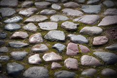 Stone pavement texture. Granite cobble stoned pavement green background. Abstract background of old cobblestone pavement Royalty Free Stock Photography