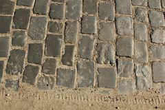 Stone pavement texture. Granite cobblestoned pavement background. Abstract background of old cobblestone pavement close-up. stock photo