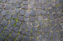 Stone pavement texture. Granite cobblestoned  background. Abstract  of old cobblestone  close-up. Seamless . Prague Royalty Free Stock Photos