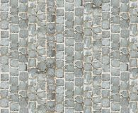 Stone pavement texture. Granite cobblestoned pavement background. Abstract background of old cobblestone pavement close-up. Seamle Royalty Free Stock Images