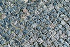 Stone pavement texture. Granite cobblestoned pavement background. Royalty Free Stock Photos