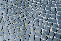 Stone pavement texture. Granite cobblestoned pavement background. Stock Photos