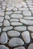 Stone pavement texture. Granite cobblestoned pavement background Stock Image