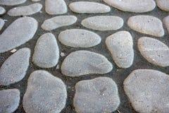 Stone pavement texture. Granite cobblestoned pavement background Stock Photo