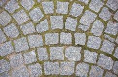 Stone pavement texture. Granite cobblestoned pavement background Stock Photos