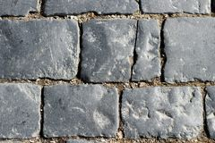 Free Stone Pavement Texture, Granite Cobblestoned Pavement Background, Cobbled Stone Road Regular Shapes, Abstract Background Royalty Free Stock Photography - 113375927
