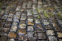 Stone pavement texture. Granite cobblestoned pavement background. stock photography