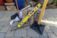 Stone Pavers and Tools for Landscaping Stock Photography
