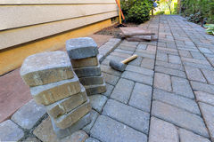 Stone Pavers and Tools for Side Yard Hardscape Stock Photo