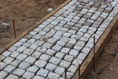 Stone pavers for walkway. A background of stone pavers being installed for a walkway royalty free stock photo
