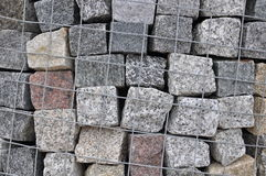 Stone paving stones of granite in a containe royalty free stock photo