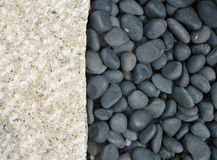 Stone and pebbles. Meet at a vertical line Stock Images