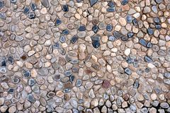 Natural wall made from rocks and stone. It is used for background and texture. Stock Photos