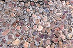 Natural wall made from rocks and stone. It is used for background and texture. Royalty Free Stock Photography