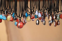 Stone pendants. Gemstone pendants in several colors - blue, red, brown, white, yellow Royalty Free Stock Image