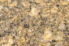 Stone with phenocrysts. Granite stone with phenocrysts,  potassium feldspar, plagioclase feldspar, quartz, and biotite Stock Photos
