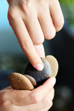 Stone. Picking up of stone on hand Stock Image