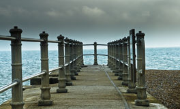 Stone pier. A stone pier and beach stock image