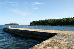 STONE pier for boats and yachts stock photos