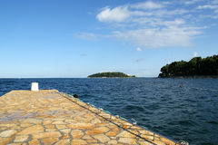 STONE pier for boats and yachts stock photography